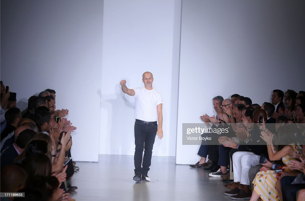 Designer <a gi-track='captionPersonalityLinkClicked' href=/galleries/search?phrase=Italo+Zucchelli&family=editorial&specificpeople=571545 ng-click='$event.stopPropagation()'>Italo Zucchelli</a> acknowledges the applause of the audience after the Calvin Klein Collection show during Milan Menswear Fashion Week Spring Summer 2014 on June 23, 2013 in Milan, Italy.