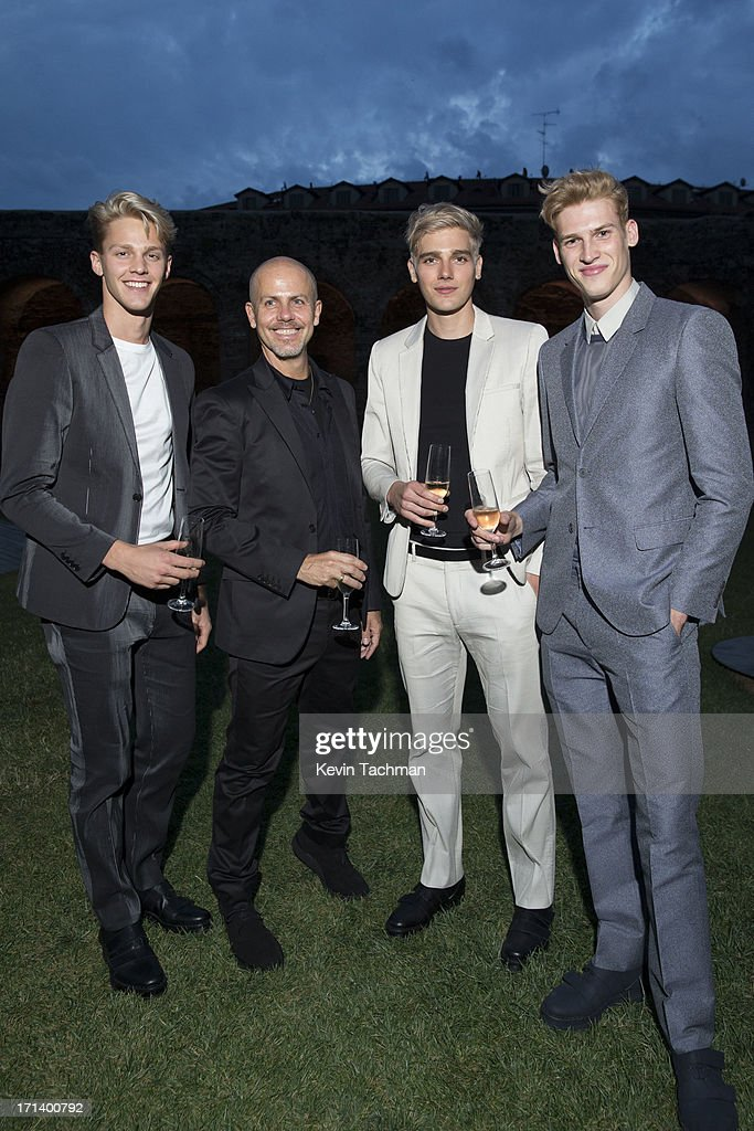 Designer <a gi-track='captionPersonalityLinkClicked' href=/galleries/search?phrase=Italo+Zucchelli&family=editorial&specificpeople=571545 ng-click='$event.stopPropagation()'>Italo Zucchelli</a>, second from left, attends the dinner to celebrate <a gi-track='captionPersonalityLinkClicked' href=/galleries/search?phrase=Italo+Zucchelli&family=editorial&specificpeople=571545 ng-click='$event.stopPropagation()'>Italo Zucchelli</a>'s ten years as Calvin Klein Collection's mens creative director on June 23, 2013 in Milan, Italy.