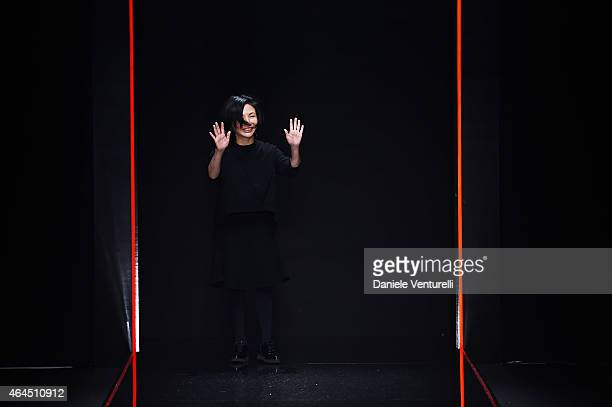 Designer Izumi Ogino acknowledges the applause of the audience after the Anteprima show during the Milan Fashion Week Autumn/Winter 2015 on February...
