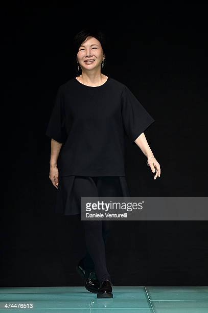 Designer Izumi Ogino aknowledge the applause of the audience after the Anteprima show as part of Milan Fashion Week Womenswear Autumn/Winter 2014 on...