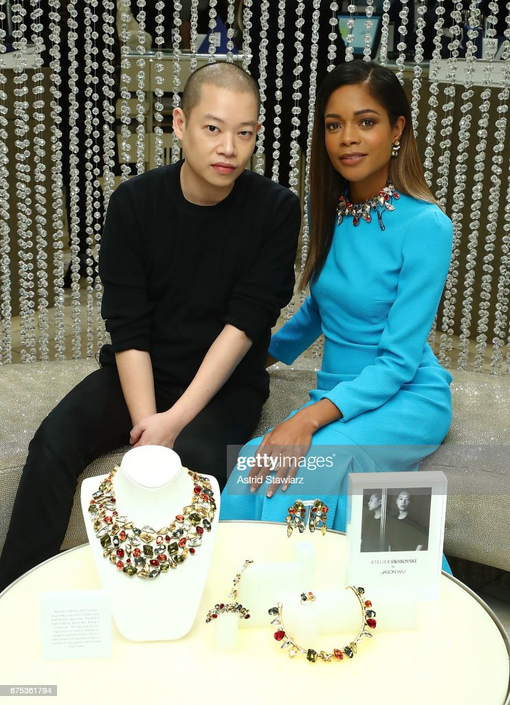 Designer Jason Wu and actress Naomie Harris poses for photos inside the Swarovski store during the 2017 Swarovski Star raising to the top of the Rockefeller Center christmas tree on November 16, 2017 in New York City.