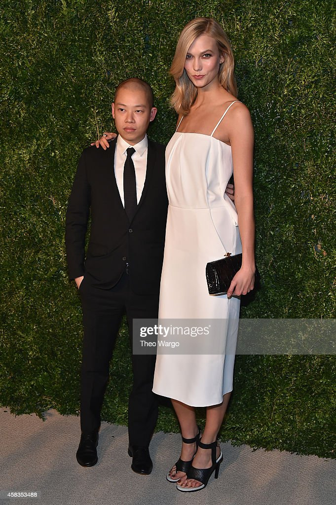 Designer Jason Wu (L) and model Karlie Kloss attend the 11th annual CFDA/Vogue Fashion Fund Awards at Spring Studios on November 3, 2014 in New York City.