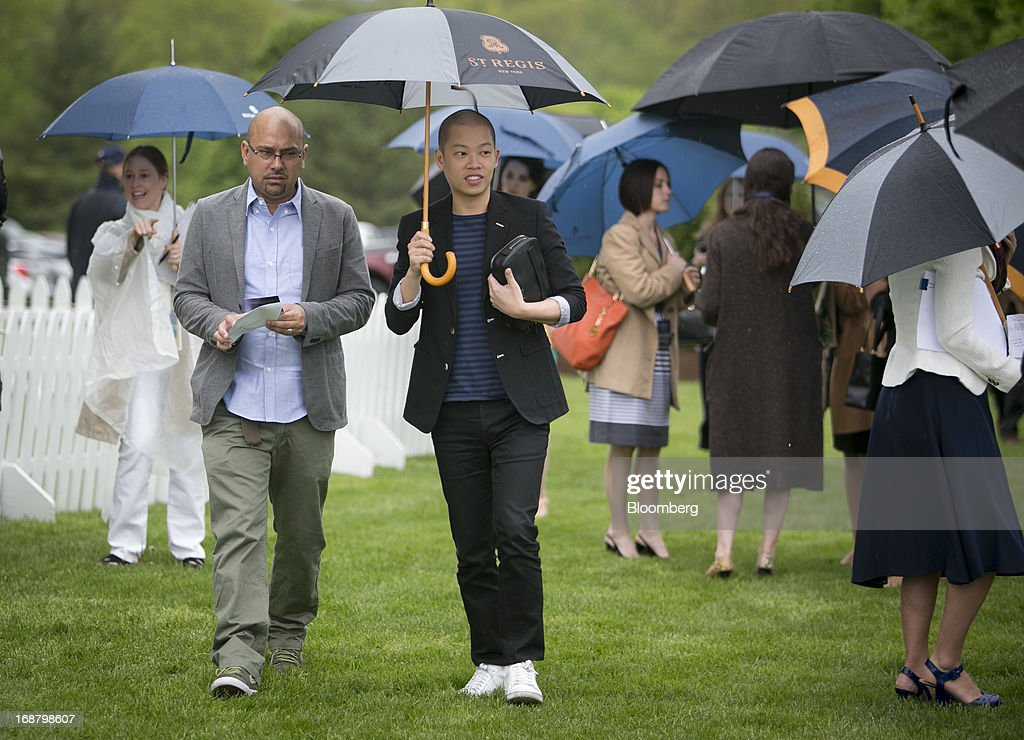 Designer Jason Wu, center, arrives during the Sentebale Royal Salute Polo Cup at the Greenwich Polo Club in Greenwich, Connecticut, U.S., on Wednesday, May 15, 2013. Prince Harry of Wales' visit is part of a week-long U.S. tour that also includes stops in Washington, Colorado and New York. Photographer: Scott Eells/Bloomberg via Getty Images