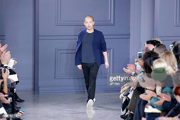 Designer Jason Wu greets the audience from the runway at Jason Wu Fall 2016 during New York Fashion Week at Spring Studios on February 12 2016 in New...