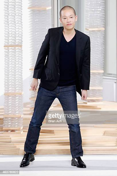 Designer Jason Wu poses on the runway at the Boss Womens fashion show during MercedesBenz Fashion Week Fall on February 18 2015 in New York City