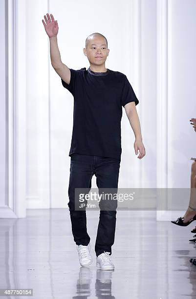 Designer Jason Wu poses on the runway with Kerastase Paris at the Jason Wu S/S 2016 fashion show during Spring Studios on September 11 2015 in New...