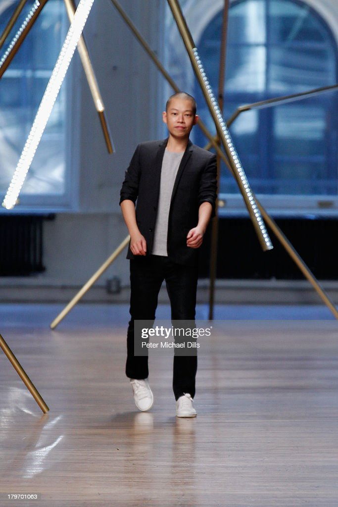 Designer Jason Wu walks the runway at the Jason Wu fashion show during Mercedes-Benz Fashion Week Spring 2014 at 82 Mercer on September 6, 2013 in New York City.