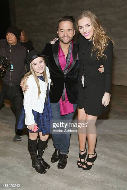 Designer Jay Godfrey with actresses Maisy Stella and Lennon Stella backstage at the Jay Godfrey fashion show during MercedesBenz Fashion Week Fall...