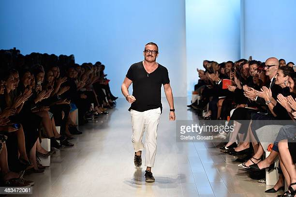Designer Jayson Brunsdon walks the runway after his show during MercedesBenz Fashion Week Australia 2014 at Carriageworks on April 9 2014 in Sydney...