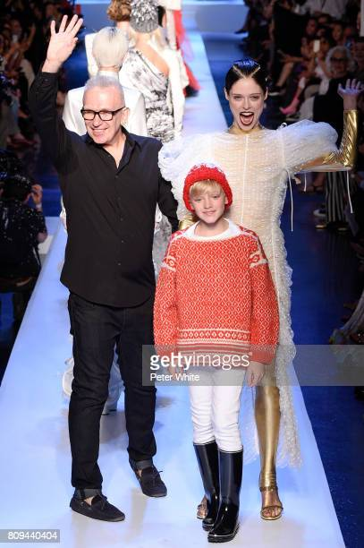 Designer Jean Paul Gaultier and Coco Rocha acknowledge the audience after the Jean Paul Gaultier Haute Couture Fall/Winter 20172018 show as part of...