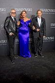 Designer Jean Paul Gaultier Francesca of Habsburg and Gerry Keszler pose for a picture on the 'black' carpet of the grand reopening of the Swarovski...