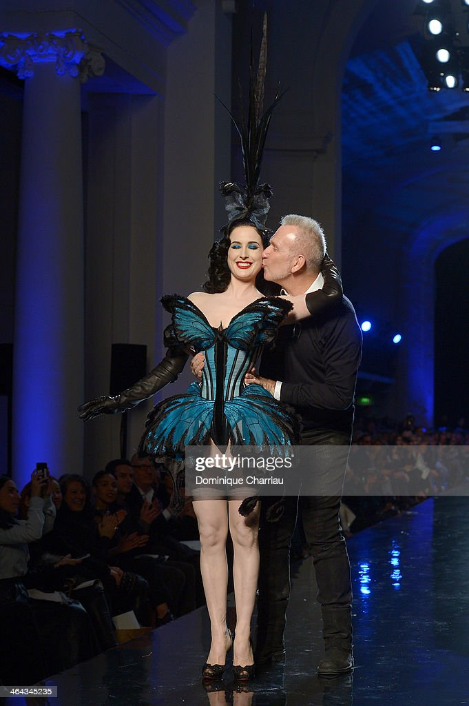 Designer Jean Paul Gaultier kisses <a gi-track='captionPersonalityLinkClicked' href=/galleries/search?phrase=Dita+Von+Teese&family=editorial&specificpeople=210578 ng-click='$event.stopPropagation()'>Dita Von Teese</a> on the runway for Jean Paul Gaultier show finale as part of Paris Fashion Week Haute Couture Spring/Summer 2014 on January 22, 2014 in Paris, France.