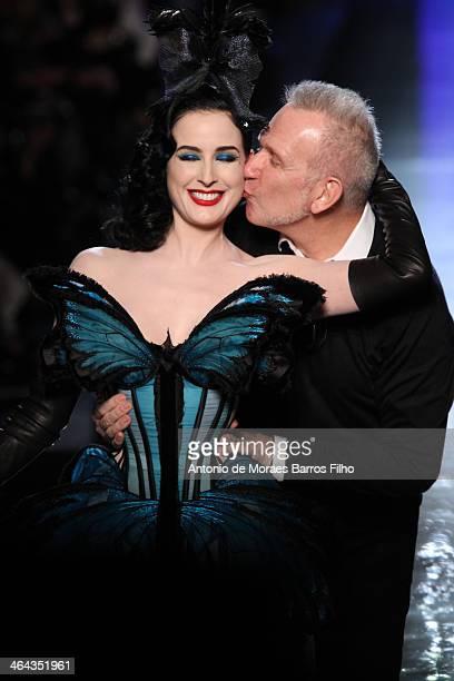 Designer Jean Paul Gaultier kisses Dita Von Teese on the runway during Jean Paul Gaultier show as part of Paris Fashion Week Haute Couture...
