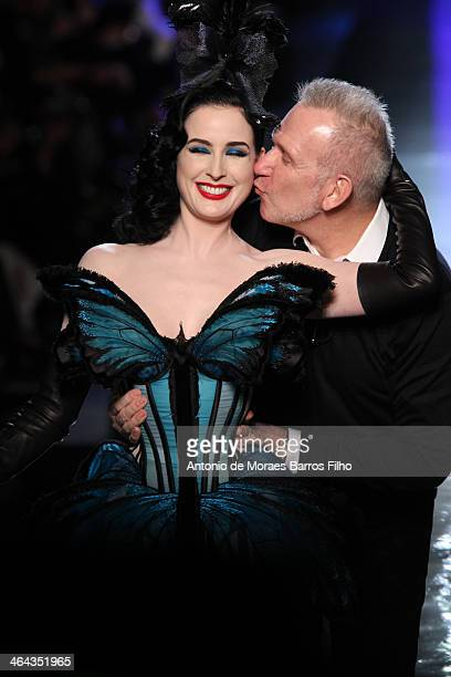 Designer Jean Paul Gaultier kisses Dita Von Teese on the runway during Jean Paul Gaultier show as part of Paris Fashion Week Haute Couture...