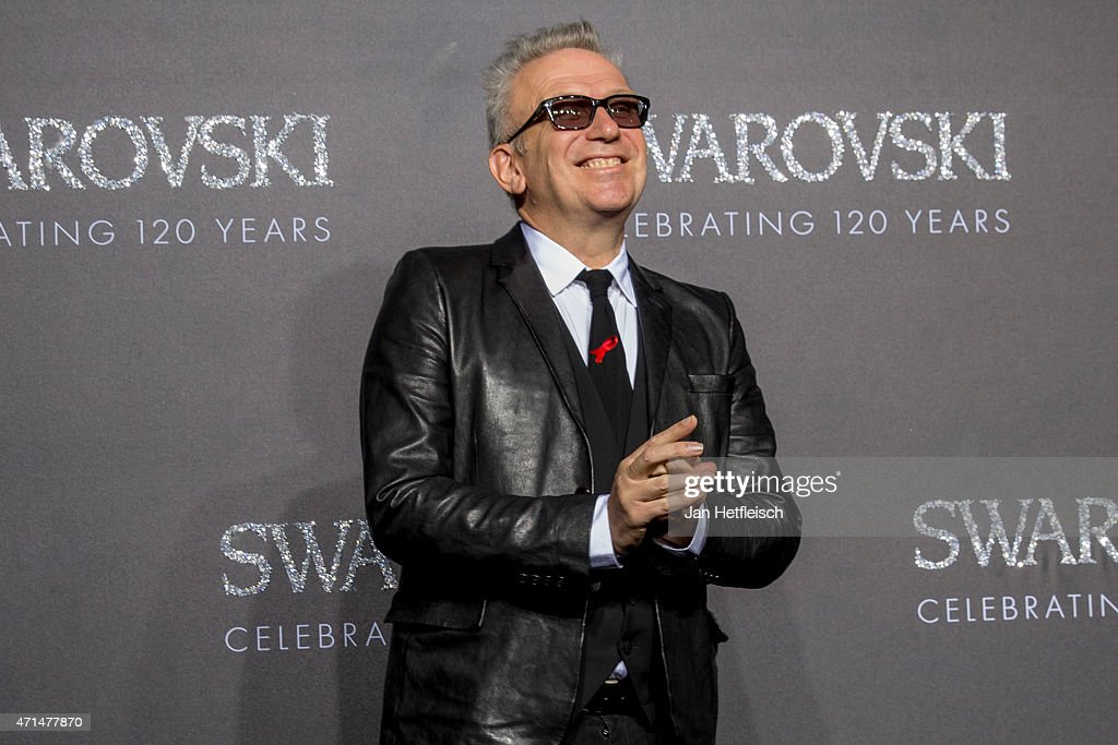 Designer Jean Paul Gaultier poses for a picture on the 'black' carpet of the grand reopening of the Swarovski Crystal Worlds on April 28 2015 in...