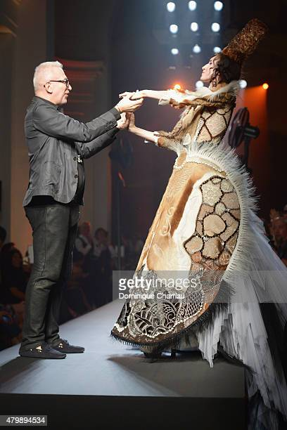 Designer Jean Paul Gaultier with a model at the end of the JeanPaul Gaultier show as part of Paris Fashion Week Haute Couture Fall/Winter 2015/2016...