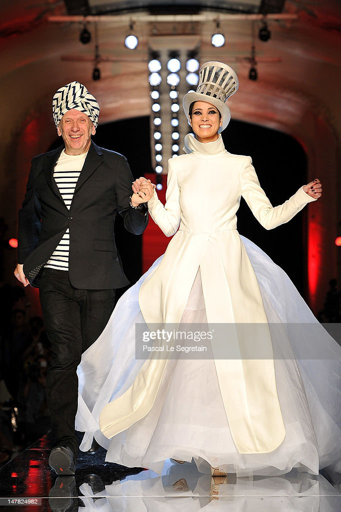 Designer Jean-Paul Gaultier and a model acknowledge the applause of the audience after the Jean-Paul Gaultier Haute-Couture show as part of Paris Fashion Week Fall / Winter 2012/13 on July 4, 2012 in Paris, France.