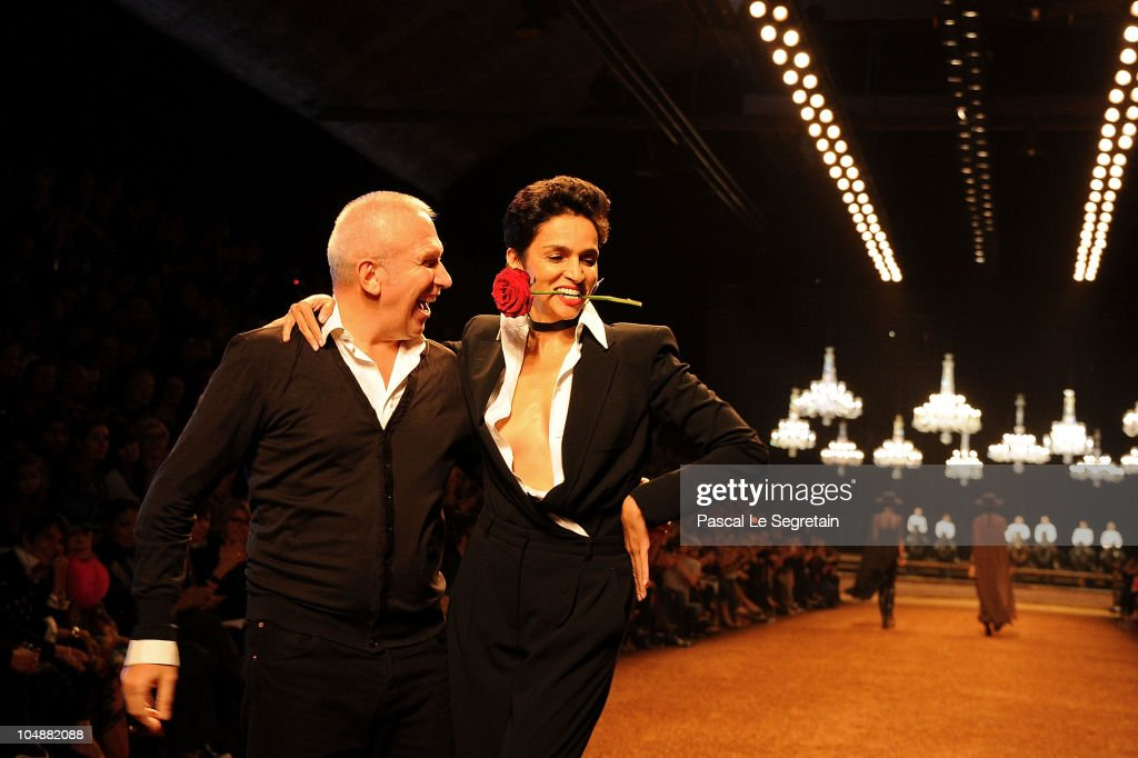 Designer JeanPaul Gaultier and Farida Khelfa walk the runway during the Hermes Ready to Wear Spring/Summer 2011 show during Paris Fashion Week at...