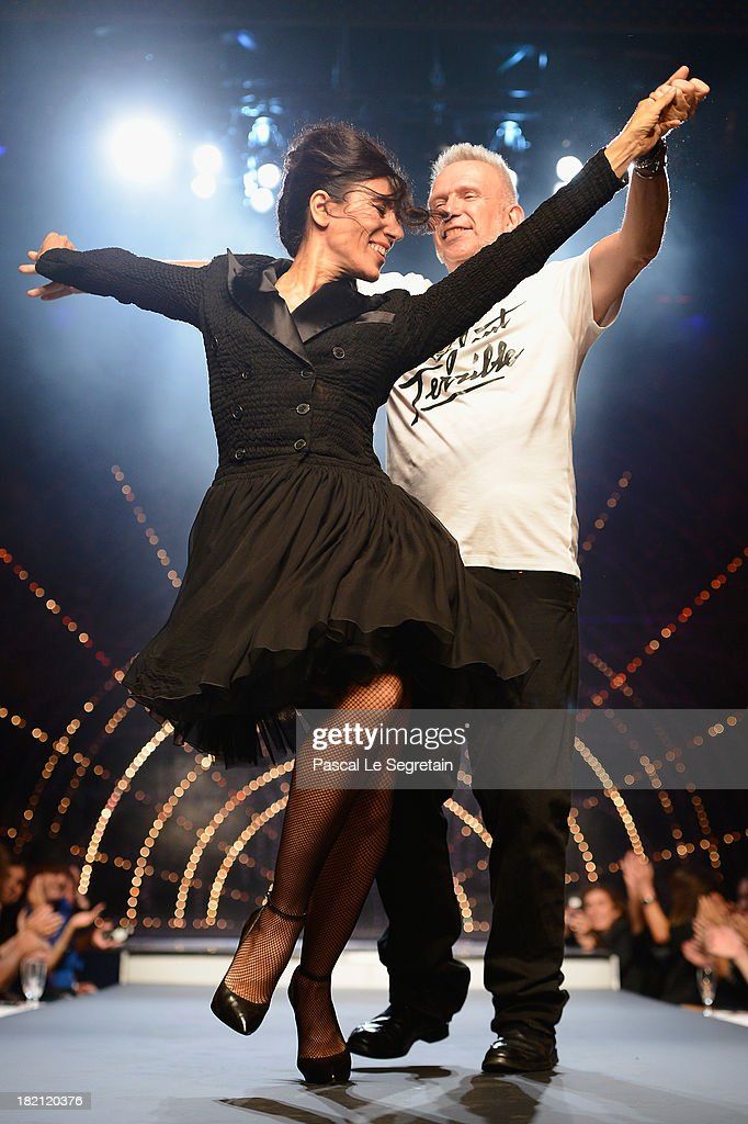 Designer Jean-Paul Gaultier dances with <a gi-track='captionPersonalityLinkClicked' href=/galleries/search?phrase=Blanca+Li&family=editorial&specificpeople=2156230 ng-click='$event.stopPropagation()'>Blanca Li</a> at the end of the Jean Paul Gaultier show as part of the Paris Fashion Week Womenswear Spring/Summer 2014 at Le Paradis Latin on September 28, 2013 in Paris, France.
