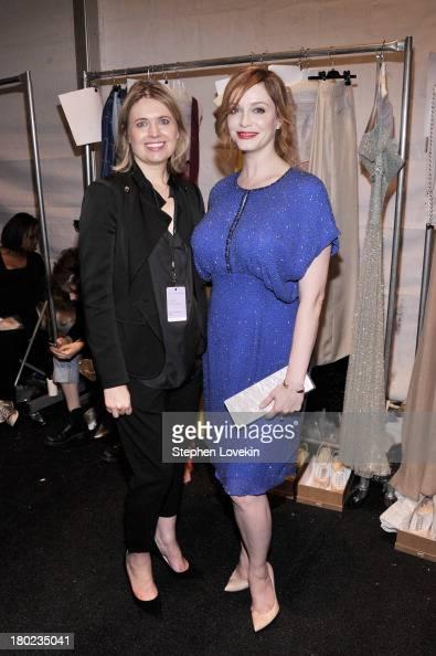 Designer Jenny Packham and Christina Hendricks pose backstage at the Jenny Packham fashion show during MercedesBenz Fashion Week Spring 2014 at The...