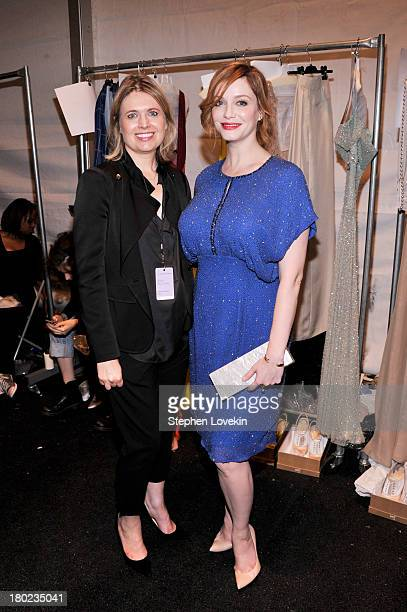Designer Jenny Packham and Christina Hendricks pose backstage at the Jenny Packham fashion show during MercedesBenz Fashion Week Spring 2014 at The...
