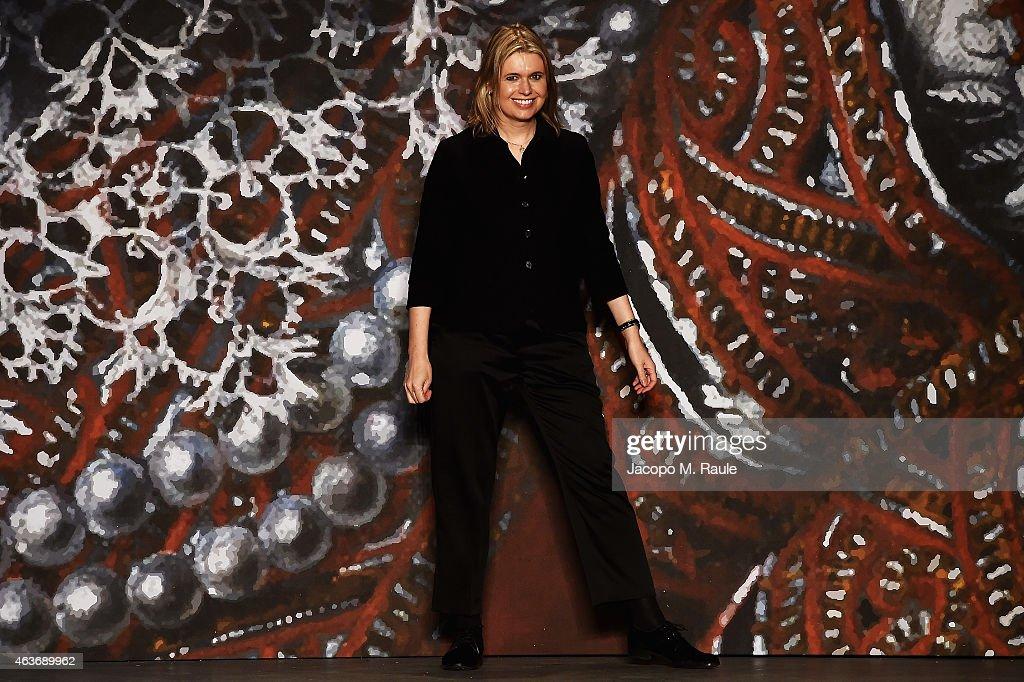 Designer Jenny Packham walks the runway at the Jenny Packham fashion show during MercedesBenz Fashion Week Fall 2015 at Industria Studios on February...