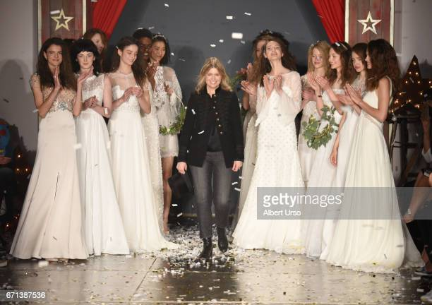 Designer Jenny Packham walks the runway with models at the Jenny Packham show during New York Fashion Week Bridal on April 21 2017 in New York City
