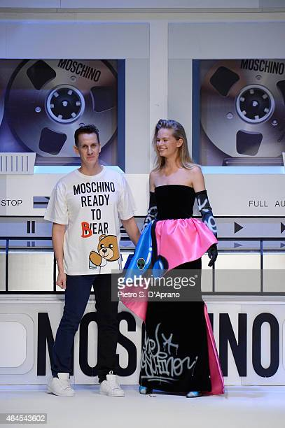 Designer Jeremy Scott acknowledges the applause of the audience after the Moschino show during the Milan Fashion Week Autumn/Winter 2015 on February...