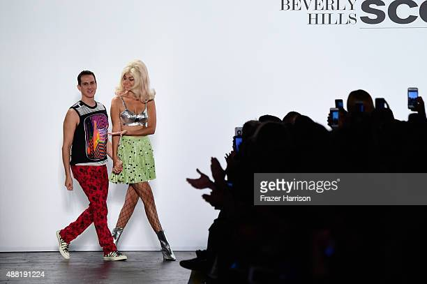 Designer Jeremy Scott and model Gigi Hadid walk the runway wearing Jeremy Scott Spring 2016 during New York Fashion Week The Shows at The Arc...
