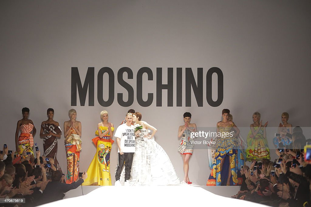 Designer <a gi-track='captionPersonalityLinkClicked' href=/galleries/search?phrase=Jeremy+Scott+-+Fashion+Designer&family=editorial&specificpeople=8682070 ng-click='$event.stopPropagation()'>Jeremy Scott</a> and models walk the runway during Moschino show as part of Milan Fashion Week Womenswear Autumn/Winter 2014 on February 20, 2014 in Milan, Italy.