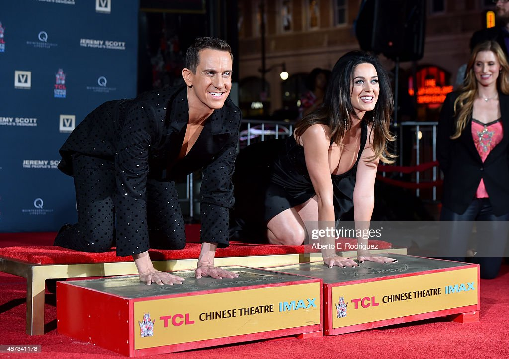 Designer Jeremy Scott (L) and singer Katy Perry are honored during their hand print ceremony at TCL Chinese Theatre IMAX Forecourt on September 8, 2015 in Hollywood, California.
