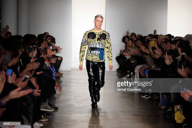 Designer Jeremy Scott walks the runway at the Jeremy Scott Fashion show during MADE Fashion Week Fall 2014 at Milk Studios on February 12 2014 in New...