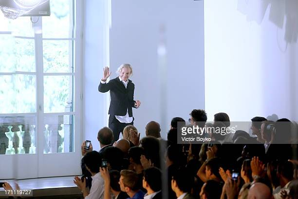 Designer Jil Sander acknowledges the applause of the audience after the Jil Sander show during Milan Menswear Fashion Week Spring Summer 2014 on June...