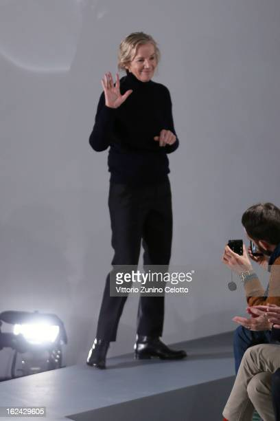 Designer Jil Sander acknowledges the applause of the audience as she walks the runway at the Jil Sander fashion show as part of Milan Fashion Week...