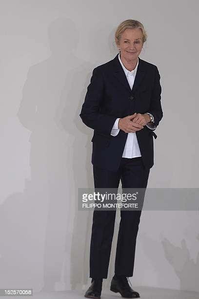Designer Jil Sander acknowledges the audience at the end of her SpringSummer 2013 collection on September 22 2012 during the Women's fashion week in...
