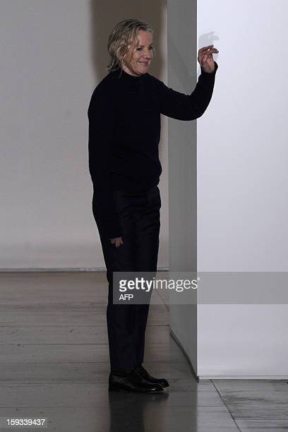 Designer Jil Sander acknowledges the audience at the end of her FallWinter 20132014 Menswear collection on January 12 2013 during the Men's fashion...
