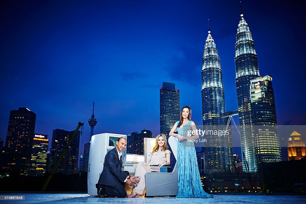 Designer Jimmy Choo actress Michelle Yeoh and supermodel Georgia May Jagger pose with a British Airways' Club World seat in front of the Petronas...