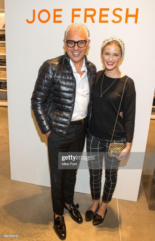 Designer Joe Mimran and Kyleigh Kuhn attend the Joe Fresh Soho opening party at Joe Fresh Soho on October 15 2013 in New York City