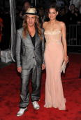 Designer John Galliano and actress Marion Cotillard attend 'The Model as Muse Embodying Fashion' Costume Institute Gala at The Metropolitan Museum of...