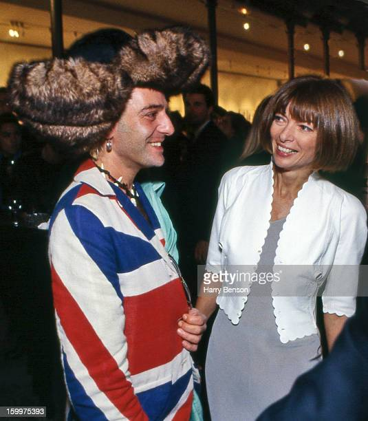 Designer John Galliano and Editor of Vogue Anna Wintour are photographed in October 1992 backstage of fashions show in Paris France