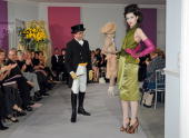 Designer John Galliano greets the audience at the Christian Dior HauteCouture show as part of the Paris Fashion Week Spring/Summer 2010 at Boutique...