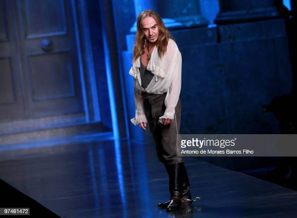 Designer John Galliano greets the audience during the Christian Dior Ready to Wear show as part of the Paris Womenswear Fashion Week Fall/Winter 2011...