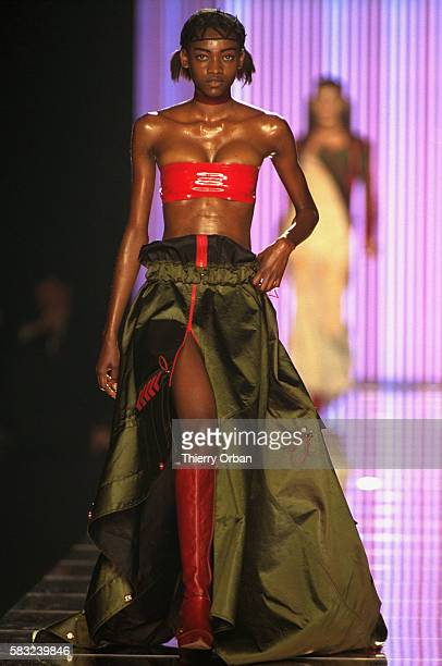 Designer John Galliano shows his women's 2002 springsummer readytowear line in Paris The model is wearing a red bandeau top with a cargostyle skirt