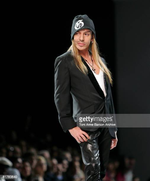 Designer John Galliano walks the runway at the Dior '09 Spring/Summer Haute Couture fashion show at the Rodin Museum on June 30 2008 in Paris France