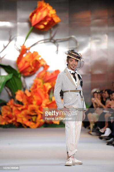 Designer John Galliano walks the runway at the end of the Dior show as part of the Paris Haute Couture Fashion Week Fall/Winter 2011 at Musee Rodin...