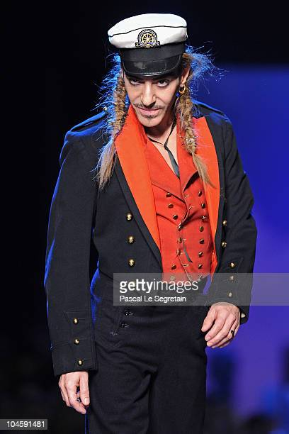 Designer John Galliano walks the runway during the Christian Dior Ready to Wear Spring/Summer 2011 show during Paris Fashion Week at Espace Ephemere...