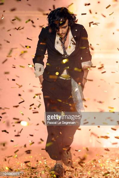 Designer John Galliano walks the runway during the John Galliano Ready to Wear Spring/Summer 2011 show during Paris Fashion Week at Opera Comique on...