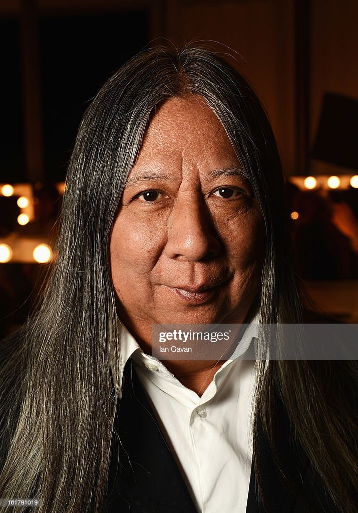 Designer John Rocha poses for a photograph backstage at the John Rocha show during London Fashion Week Fall/Winter 2013/14 at Somerset House on February 16, 2013 in London, England.
