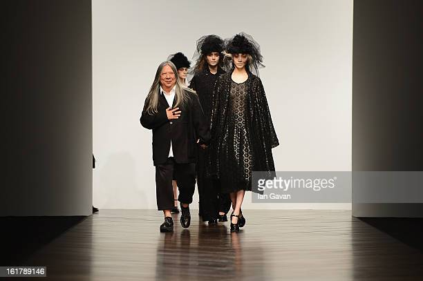 Designer John Rocha walks the runway with his models at the John Rocha show during London Fashion Week Fall/Winter 2013/14 at Somerset House on...