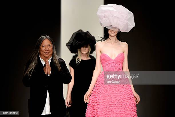 Designer John Rocha walks with his models on the catwalk by John Rocha on day 2 of London Fashion Week Spring/Summer 2013 at the Courtyard Show Space...